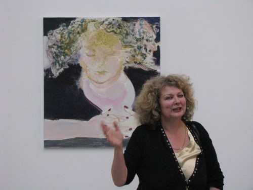 Marlene-Dumas-in-front-of-self-portrait-The-Sleep-of-Reason-2009-press-preview-for-Against-the-Wall-David-Zwirner-2010.jpg