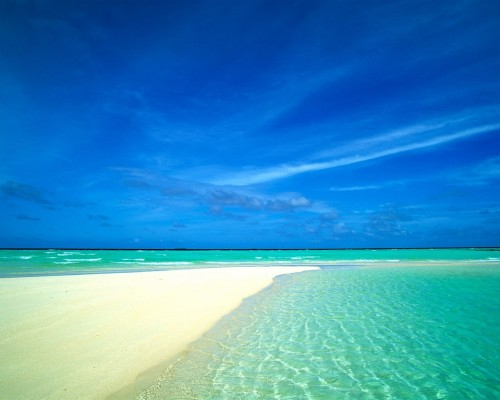 blue_sea_and_sandy_beaches_surrounded_by_wallpaper_1280x1024.jpg